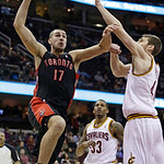 Toronto Raptors' Jonas Valanciunas (17) jumps to the basket against Cleveland Cavaliers' Tyler Zeller, right, during the first quarter of an NBA basketball game Wednesday, Feb. 27, 2013, in  …