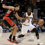 Cleveland Cavaliers' Dion Waiters (3) drives past Toronto Raptors' Landry Fields (2) during the second quarter of an NBA basketball game Wednesday, Feb. 27, 2013, in Cleveland. Waiters score …