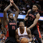 Toronto Raptors' Amir Johnson (15) and Rudy Gay (22) put pressure on Cleveland Cavaliers' Alonzo Gee during the second quarter of an NBA basketball game Wednesday, Feb. 27, 2013, in Clevelan …