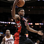 Toronto Raptors' Rudy Gay (22) grabs a rebound in front of Cleveland Cavaliers' Alonzo Gee (33) during the first quarter of an NBA basketball game Wednesday, Feb. 27, 2013, in Cleveland. (AP …