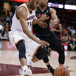 Cleveland Cavaliers' Wayne Ellington, left, works against Toronto Raptors' Sebastian Telfair during the fourth quarter of an NBA basketball game Wednesday, Feb. 27, 2013, in Cleveland. The C …
