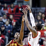 Portland Trail Blazers forward LaMarcus Aldridge, right, puts up a shot against Cleveland Cavaliers forward Tristan Thompson during the first quarter of an NBA basketball game in Portland, O …