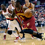 Cleveland Cavaliers guard Dion Waiters, right, drives to the basket past Portland Trail Blazers guard Wesley Matthews during the first quarter of an NBA basketball game in Portland, Ore., We …