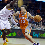 Phoenix Suns' Steve Nash (13) drives past Cleveland Cavaliers' J.J. Hickson (21) in the fourth quarter in an NBA basketball game Wednesday, Jan. 19, 2011, in Cleveland. The Suns won 106-98.  …