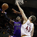 Sacramento Kings' Jason Thompson (34) shoots over Cleveland Cavaliers' Tyler Zeller (40) during the first quarter of an NBA basketball game on Wednesday, Jan. 2, 2013, in Cleveland. Thompson …