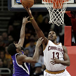 Cleveland Cavaliers' Tristan Thompson, right, shoots over Sacramento Kings' John Salmons during the first quarter of an NBA basketball game on Wednesday, Jan. 2, 2013, in Cleveland. (AP Phot …