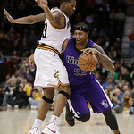 Sacramento Kings' James Johnson, right, drives past Cleveland Cavaliers' Alonzo Gee during the fourth quarter of an NBA basketball game on Wednesday, Jan. 2, 2013, in Cleveland. The Kings wo …