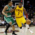 Cleveland Cavaliers' Kyrie Irving (2) drives past Boston Celtics' Avery Bradley (0) during the second quarter of an NBA basketball game Tuesday, Jan. 22, 2013, in Cleveland. (AP Photo/Tony D …