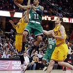 Boston Celtics' Courtney Lee (11) jumps to the basket against Cleveland Cavaliers' Shaun Livingston (14) and Tyler Zeller (40) during the fourth quarter of an NBA basketball game Tuesday, Ja …