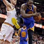 Golden State Warriors' Draymond Green (23) pulls down a rebound against Cleveland Cavaliers' Tyler Zeller in the fourth quarter of an NBA basketball game Tuesday, Jan. 29, 2013, in Cleveland …