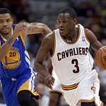 Cleveland Cavaliers' Dion Waiters (3) drives past Golden State Warriors' Kent Bazemore (20) in the second quarter of an NBA basketball game Tuesday, Jan. 29, 2013, in Cleveland. The Warriors …