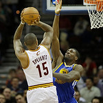 Golden State Warriors' Festus Ezeli (31), from Nigeria, defends a shot by Cleveland Cavaliers' Marreese Speights (15) in an NBA basketball game Tuesday, Jan. 29, 2013, in Cleveland. (AP Phot …
