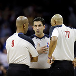 Referee Zach Zarba , center, confers with  Derrick Stafford (9) and Karl Lane (77) during an NBA basketball game between the the Golden State Warriors and Cleveland Cavaliers Tuesday, Jan. 2 …