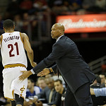 Cleveland Cavaliers head coach Byron Scott, right, pats Cleveland Cavaliers' Wayne Ellington (21) during an NBA basketball game against the Golden State Warriors Tuesday, Jan. 29, 2013, in C …