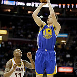 Golden State Warriors' Klay Thompson (11) shoots against Cleveland Cavaliers' Alonzo Gee (33) in an NBA basketball game Tuesday, Jan. 29, 2013, in Cleveland. (AP Photo/Mark Duncan)