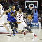 Cleveland Cavaliers' Dion Waiters (3) runs Golden State Warriors' Kent Bazemore into a pick from Tyler Zeller (40) in an NBA basketball game Tuesday, Jan. 29, 2013, in Cleveland. (AP Photo/M …