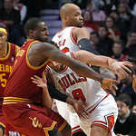 Cleveland Cavaliers guard Dion Waiters (3) knocks the ball away from Chicago Bulls guard Marco Belinelli (8) as Kevin Jones (5) and Taj Gibson watch during the first half of an NBA basketbal …