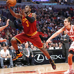 Cleveland Cavaliers guard Dion Waiters (3) scores past Chicago Bulls center Joakim Noah during the first half of an NBA basketball game Monday, Jan. 7, 2013, in Chicago. (AP Photo/Charles Re …