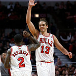 Chicago Bulls' Joakim Noah (13) celebrates with Nate Robinson during the second half of an NBA basketball game against the Cleveland Cavaliers on Monday, Jan. 7, 2013, in Chicago. The Bulls  …