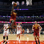 Cleveland Cavaliers guard Dion Waiters (3) drives and scores in front of Chicago Bulls' Nate Robinson (2) and Joakim Noah (13) as Cavaliers' Omri Casspi watches during the second half of an  …