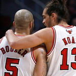 Chicago Bulls' Carlos Boozer and Joakim Noah talk during a break in the first half of an NBA basketball game against the Cleveland Cavaliers on Monday, Jan. 7, 2013, in Chicago. (AP Photo/Ch …