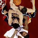 Atlanta Hawks' Kyle Korver, top, fights for a rebound with Zaza Pachulia and Cleveland Cavaliers' Tristan Thompson, bottom, in the first half of an NBA basketball game, Wednesday, Jan. 9, 20 …