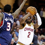 Cleveland Cavaliers' Kyrie Irving (2) shoots a 3-pointer over Atlanta Hawks' Louis Williams (3) in the first quarter of an NBA basketball game, Wednesday, Jan. 9, 2013, in Cleveland. (AP Pho …