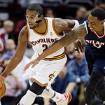 Cleveland Cavaliers' Kyrie Irving (2) steals the ball from Atlanta Hawks' Jeff Teague in the first quarter of an NBA basketball game, Wednesday, Jan. 9, 2013, in Cleveland. (AP Photo/Mark Du …