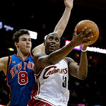 Cleveland Cavaliers forward Jawad Williams, right, jumps to the basket against New York Knicks forward Danilo Gallinari, from Italy, in the fourth quarter in an NBA basketball game Monday, M …