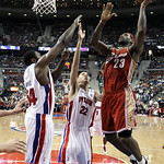 Cleveland Cavaliers forward LeBron James (23) drives on Detroit Pistons defenders Jason Maxiell (54) an Tayshaun Prince (22) in the second half of an NBA basketball game in Auburn Hills, Mic …