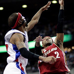 Cleveland Cavaliers guard Mo Williams (2) takes a shot against Detroit Pistons forward Richard Hamilton in the second half of an NBA basketball game Tuesday, March 16, 2010, in Auburn Hills, …