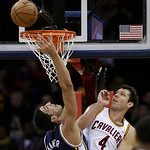 Utah Jazz's Enes Kanter (0), from Turkey, jumps to the basket against Cleveland Cavaliers' Luke Walton (4) during the second quarter of an NBA basketball game Wednesday, March 6, 2013, in Cl …