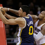 Utah Jazz's Enes Kanter (0), from Turkey, and Cleveland Cavalier's Marreese Speights (15) vie for a rebound during the third quarter of an NBA basketball game Wednesday, March 6, 2013, in Cl …