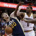 Utah Jazz's Gordon Hayward (20) is fouled by Cleveland Cavaliers' C.J. Miles (0) during the fourth quarter of an NBA basketball game Wednesday, March 6, 2013, in Cleveland. The Cavaliers won …