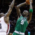 Boston Celtics' Kevin Garnett (5) shoots over Cleveland Cavaliers' Shaquille O'Neal in the fourth quarter of Game 5 in a second round NBA basketball playoff series Tuesday, May 11, 2010, in  …