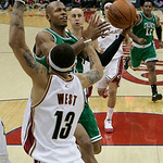 Boston Celtics' Ray Allen goes up for a shot against Cleveland Cavaliers' Delonte West (13) in the second quarter of Game 5 of a second round NBA basketball playoff series Tuesday, May 11, 2 …