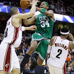Boston Celtics' Paul Pierce (34) shoots between Cleveland Cavaliers' Anthony Parker and Mo Williams (2) in the fourth quarter of Game 5 of a second round NBA basketball playoff series Tuesda …