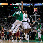 Boston Celtics forward Glen Davis, right, leaps as he high-fives teammate Nate Robinson after hitting a basket against the Cleveland Cavaliers during the fourth quarter of Game 4 in a second …