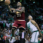 Cleveland Cavaliers forward LeBron James loses his grip on the ball after driving past Boston Celtics center Rasheed Wallace, right during the second half of Game 4 in a second-round NBA bas …