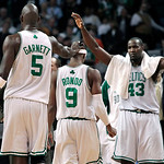 Boston Celtics guard Rajon Rondo (9) receives a pat on the head from Kevin Garnett (5) as Kendrick Perkins (43) celebrates during the fourth quarter against the Cleveland Cavaliers during Ga …