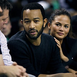 Singer John Legend and model Chrissy Teigen sit courtside during Game 4 between the Boston Celtics and the Cleveland Cavaliers in a second-round NBA basketball playoff series in Boston on Su …