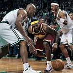 Cleveland Cavaliers forward LeBron James, middle, loses control of the ball after getting fouled by Boston Celtics forward Paul Pierce, right, as Celtics guard Ray Allen, left, closes in dur …
