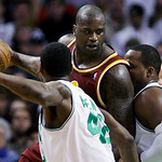 Cleveland Cavaliers center Shaquille O'Neal, center, is cornered by Boston Celtics center Glen Davis, right, and guard Tony Allen during the first half of Game 4 in a second-round NBA basket …