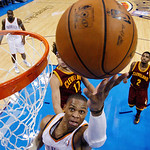 Oklahoma City Thunder guard Russell Westbrook (0) shoots in front of Cleveland Cavaliers center Anderson Varejao (17) in the second quarter of an NBA basketball game in Oklahoma City, Sunday …
