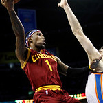 Cleveland Cavaliers guard Daniel Gibson (1) shoots in front of Oklahoma City Thunder forward Nick Collison, right, in the second quarter of an NBA basketball game in Oklahoma City, Sunday, N …
