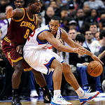 Philadelphia 76ers' Evan Turner (12) backs into Cleveland Cavaliers' Jeremy Pargo (8) during the first half of an NBA basketball game, Sunday, Nov. 18, 2012, in Philadelphia. The 76ers won 8 …