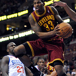 Cleveland Cavaliers' Alonzo Gee (33) drives past Philadelphia 76ers' Jason Richardson (23) during the first half of an NBA basketball game on Sunday, Nov. 18, 2012, in Philadelphia. (AP Phot …