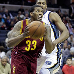 Cleveland Cavaliers' Alonzo Gee (33) goes to the basket around Memphis Grizzlies' Rudy Gay during the first half of an NBA basketball game in Memphis, Tenn, Monday, Nov. 26, 2012. (AP Photo/ …
