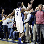 Memphis Grizzlies fans cheer and greet Memphis Grizzlies' Tony Allen during a timeout late in the second half of an NBA basketball game against the Cleveland Cavaliers in Memphis, Tenn, Mond …