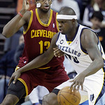 Memphis Grizzlies' Zach Randolph, right, moves the ball around Cleveland Cavaliers' Tristan Thompson (13), during the first half of an NBA basketball game in Memphis, Tenn, Monday, Nov. 26,  …